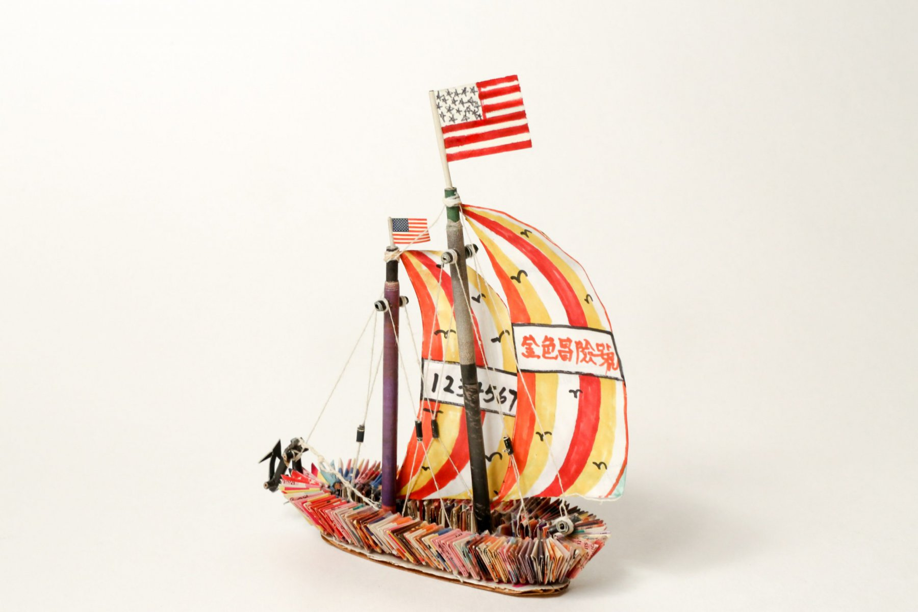 Sailboat (Golden Venture, Golden Vision), 1995, folded magazine pages, rolled and cut white paper, cardboard, thread, liquid glue and colored marker, Museum of Chinese in America (MOCA) Collections