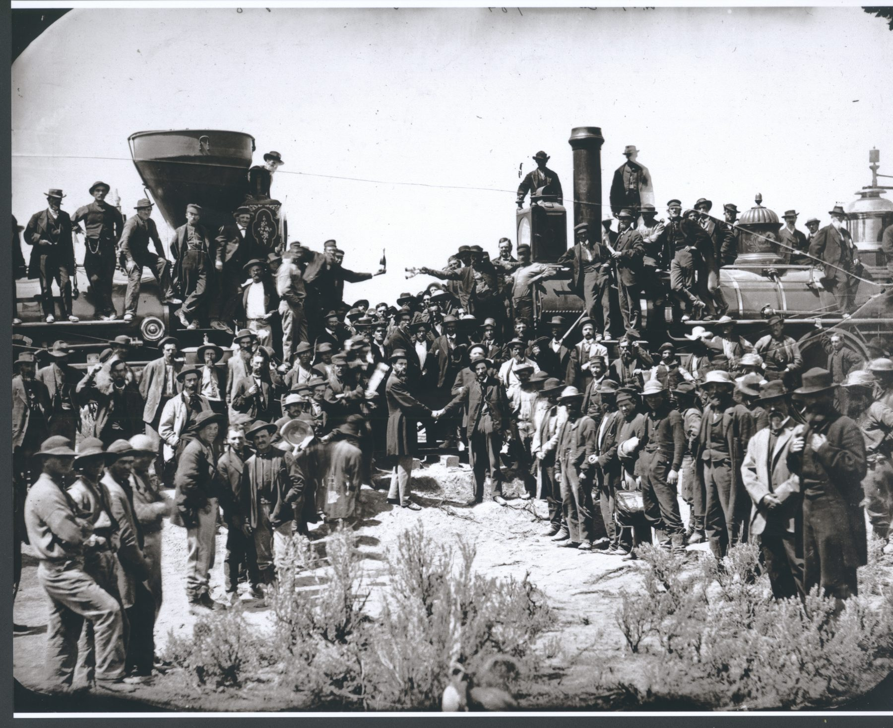 "10 May 2019 Posted. ""East and West Shaking hands at laying Last Rail"" by Andrew J. Russell on May 10, 1869 at Promontory Summit, Utah, displayed at the Museum of Chinese in America (MOCA) core exhibition, Courtesy of the Union Pacific Railroad Museum. 摄影师Andrew J. Russell拍摄的""东西两段铁路的胜利会师"",1869年5月10日,犹他州海角峰,美国华人博物馆(MOCA)核心展览展出图片,联合太平洋铁路博物馆馆藏"