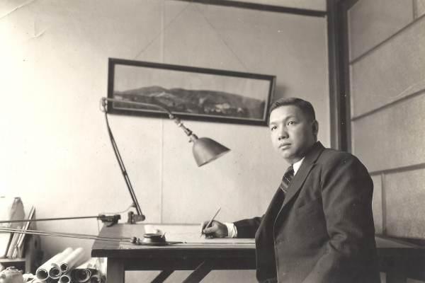 Poy Gum Lee at his desk